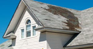 Home with roof tiles missing, damaged © iStock
