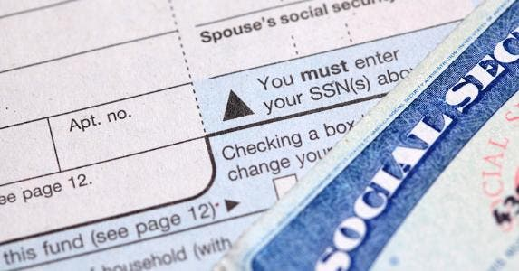 Social security card and tax form © iStock