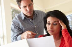 Husband and wife looking over documents © iStock
