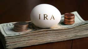 How would I go about rolling my IRA into real estate?