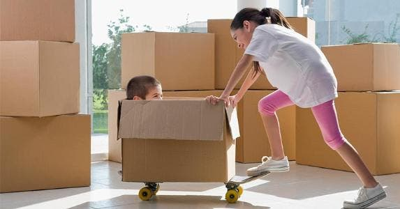 Children playing with moving boxes | Glow Images, Inc/Getty Images