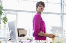 Woman working in bright, open office space | Hero Images/Getty Images