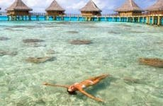 Woman swimming in vacation resort | M Swiet Productions/Moment/Getty Images