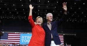 Hillary and Bill Clinton waving | Justin Sullivan/Getty Images