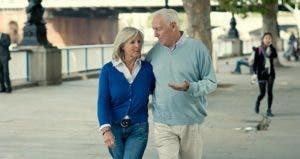 Older couple walking along bridge, talking | VisitBritain/Getty Images