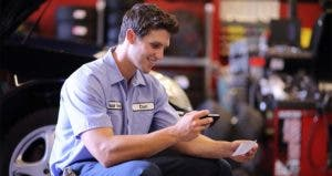 Mechanic depositing check with a mobile app | PhotoInc/Getty Images
