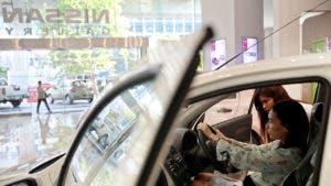 Woman in car in Nissan dealership