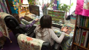 two girls playing Minecraft