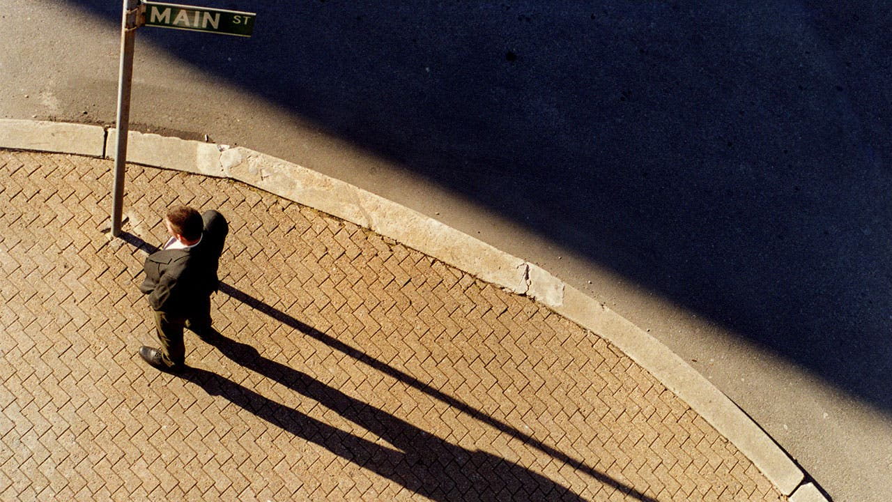 Man with a long shadow