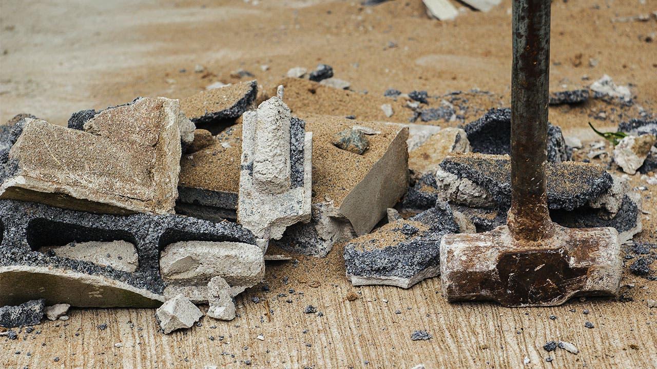 Sledgehammer and debris