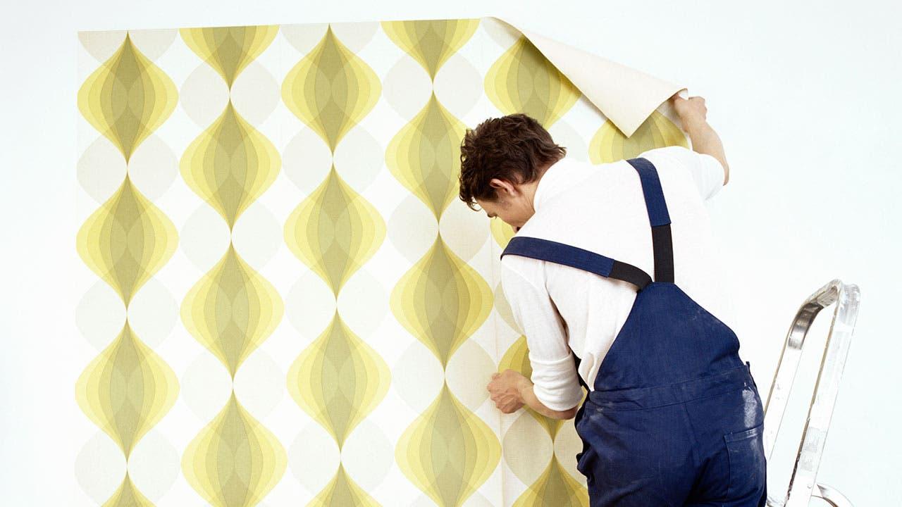 Man applying wallpaper