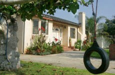 Home and yard with tire swing