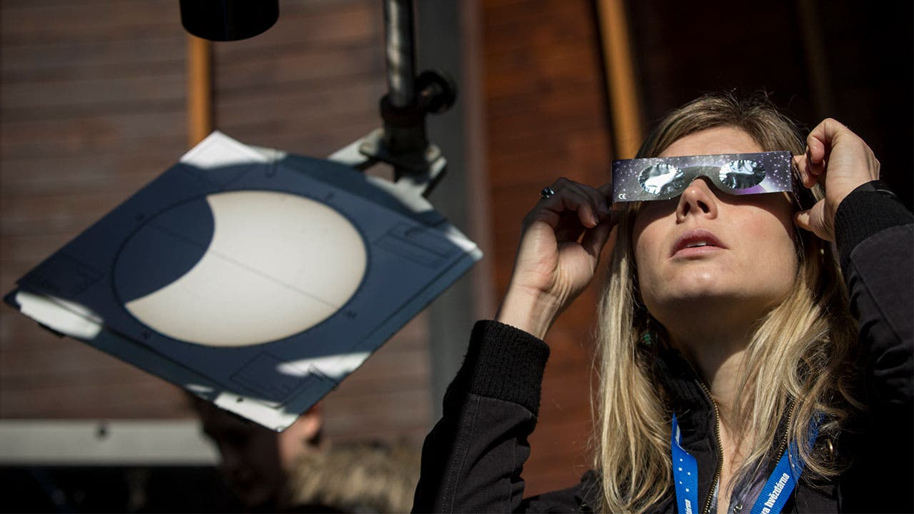 Woman watching the solar eclipse