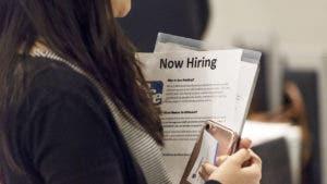 Woman clutching a job posting
