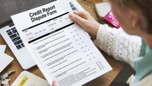 Woman reviewing credit report dispute form