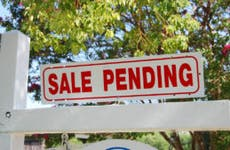 """""""Sale pending"""" sign outside a home"""