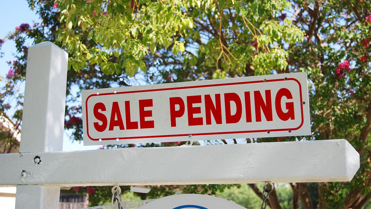"""Sale pending"" sign outside a home"
