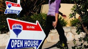 Woman walking into open house