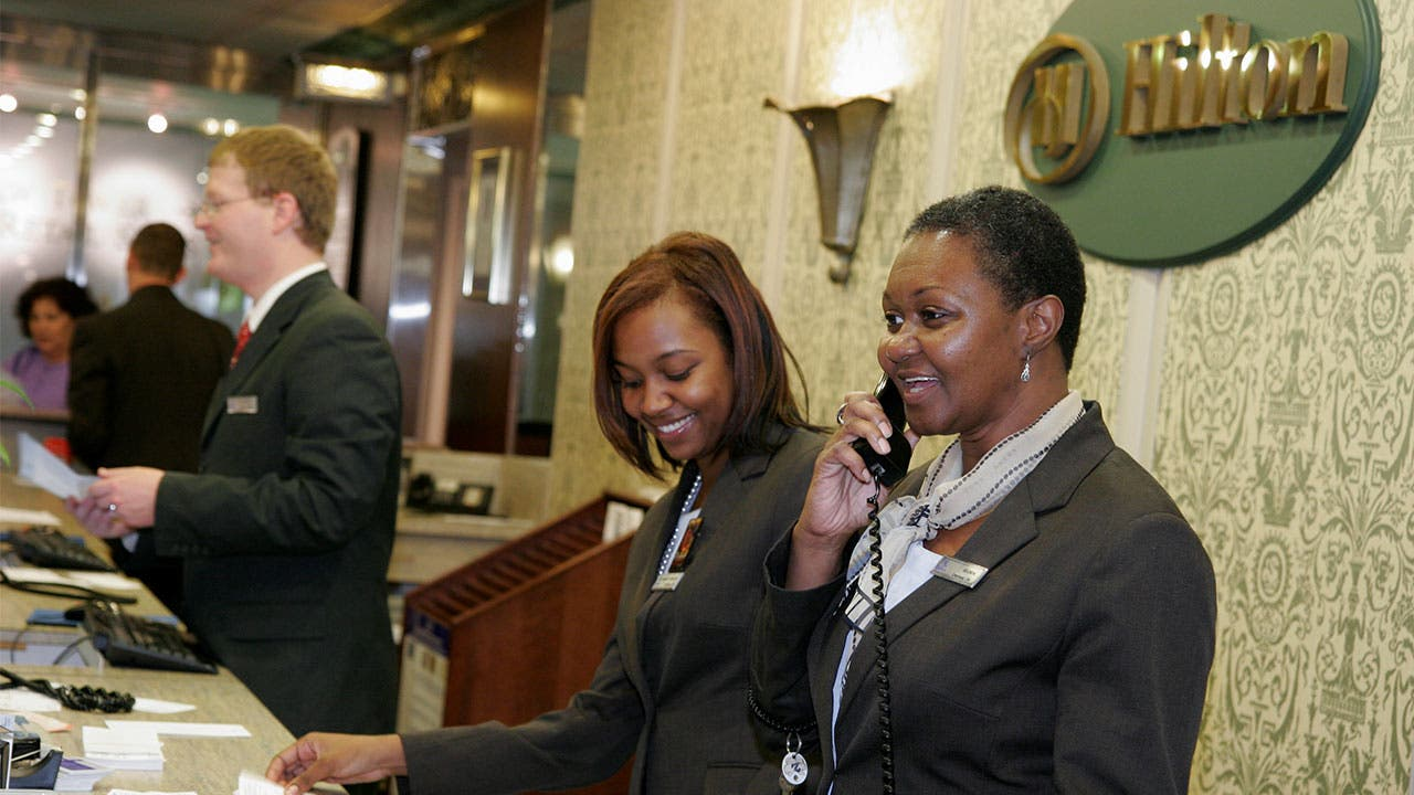 Hotel worker answering phone