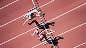 women jumping hurdles race