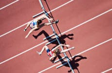 women jumping hurdles race