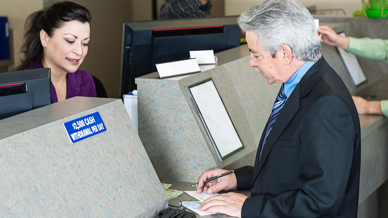 Man making a deposit at credit union