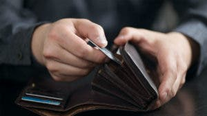 Man taking credit card out of wallet