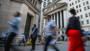 People walking by New York Stock Exchange