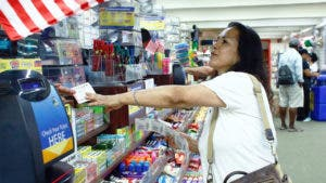 Woman buying powerball tickets