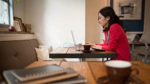 Woman at coffeeshop on laptop