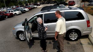 Woman and man talking at a car lot
