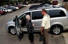 Woman and man talking at a car lot