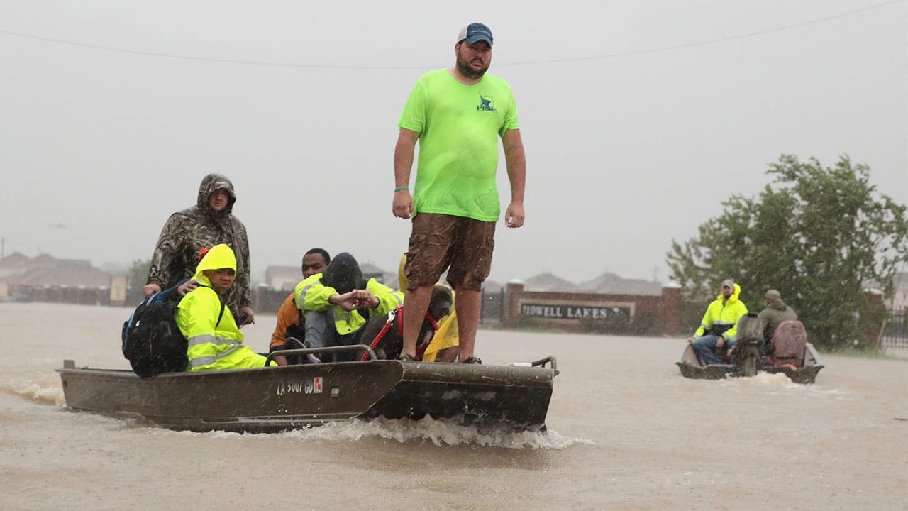 Hurricane Harvey floods have forced residents into boats