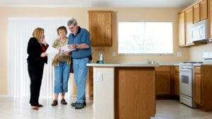 Couple with agent looking at house