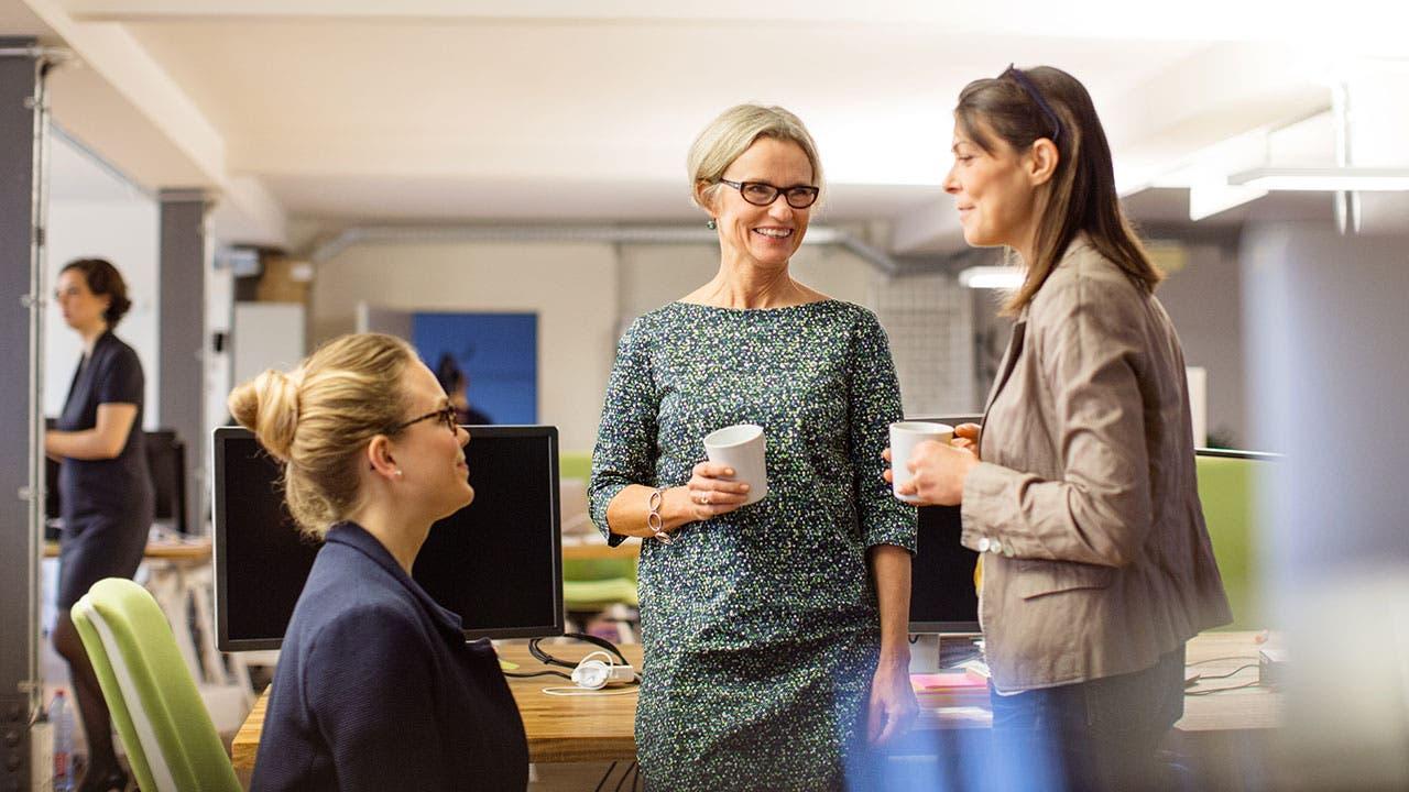 Three women talking at work