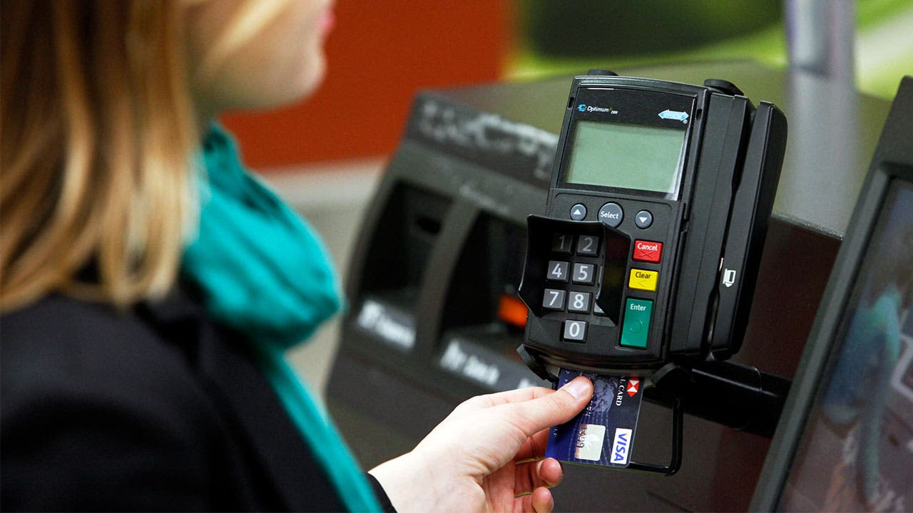 Woman using a chip credit card reader
