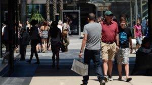 American shoppers walking outside shopping area