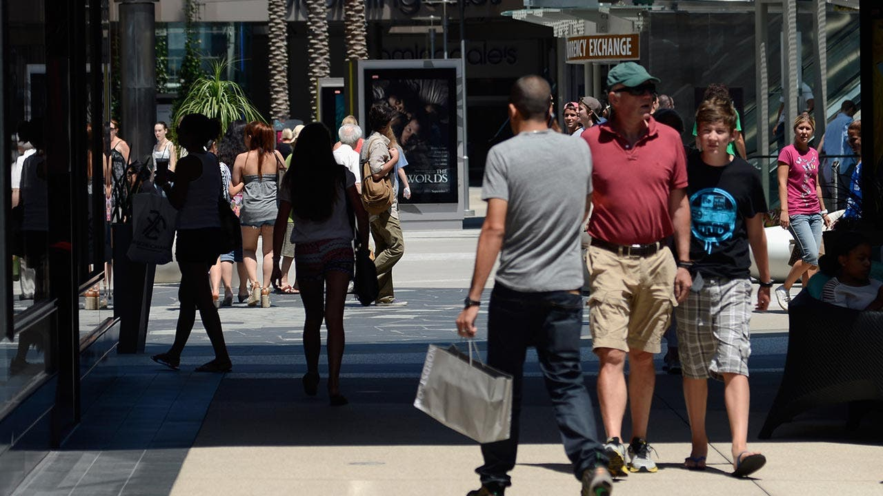 American shoppers walking outside shopping area
