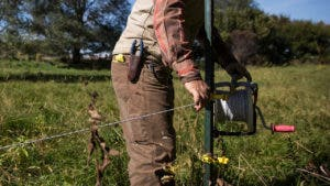 Man installing an electric fence