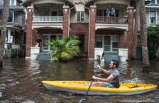 Man in Jacksonville paddles through flooding