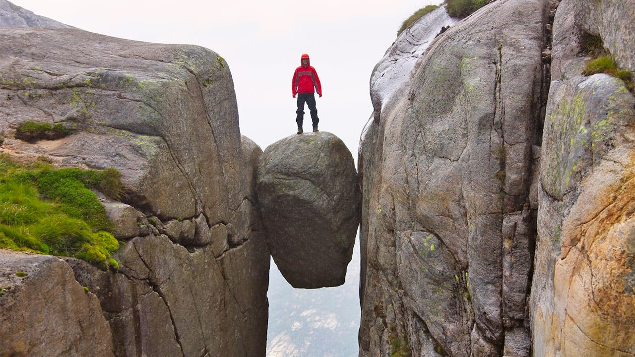 Man standing on rock in Norway