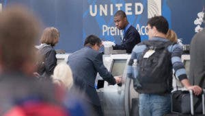 Passengers at United gate checking in