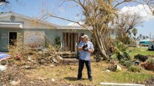 Man in his yard in Marathon, Florida after Hurricane Irma