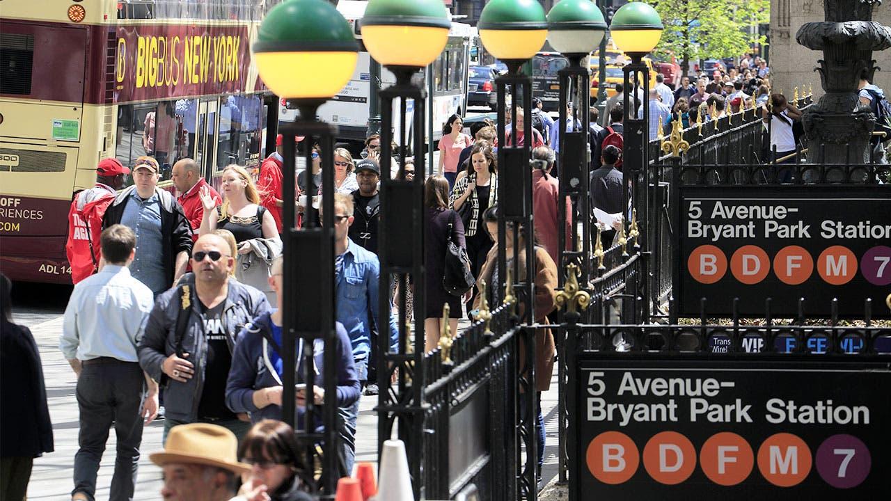 Pedestrians walking through Manhattan