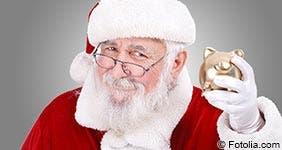 Santa Claus holding piggy bank
