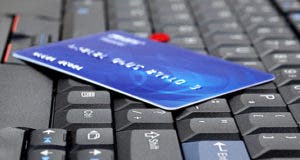 Blue plastic card laying on keyboard © NAN728/Shutterstock.com