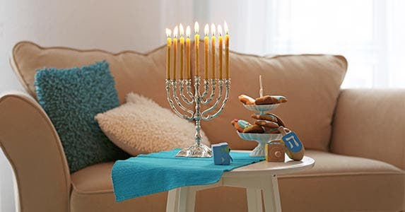 Create party ambiance with candles, scents | Africa Studio/Shutterstock.com