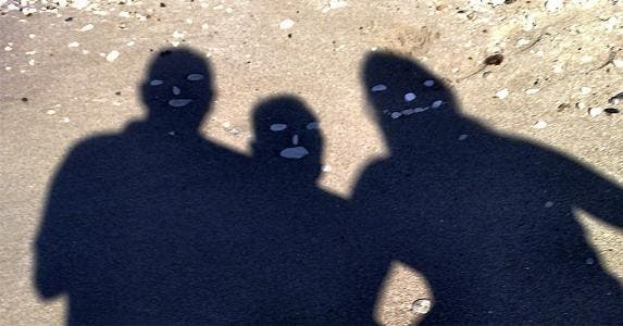 Three men making shadow silhouette on the ground | Niko Miaoulis /EyeEm/Getty Images