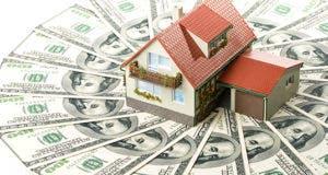 Peach house on money © Dmitry Melnikov/Shutterstock.com