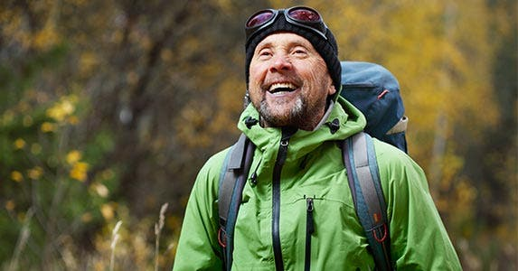 Hiker with backpack smiling